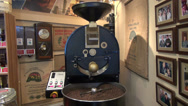 Stock Video Footage of Commercial drum type coffee roaster, coffee shop, roasting coffee beans
