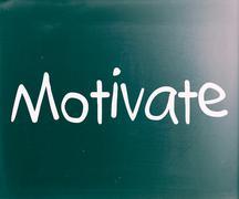 """motivate"" handwritten with white chalk on a blackboard - stock illustration"