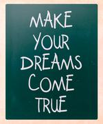"""Stock Illustration of """"make your dreams come true"""" handwritten with white chalk on a blackboard"""