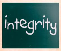 "Stock Photo of ""integrity"" handwritten with white chalk on a blackboard"