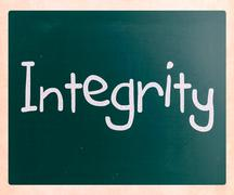"""The word """"integrity"""" handwritten with white chalk on a blackboard Stock Photos"""