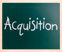 """The word """"acquisition"""" handwritten with white chalk on a blackboard Stock Photos"""
