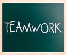 "The word ""teamwork"" handwritten with white chalk on a blackboard Stock Photos"