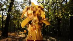 Woman Throwing Leaves in Forest Autumn Fall Happiness Concept - stock footage