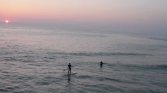 Malibu Surfers at Sunset In Ocean Stock Footage