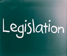 "Stock Photo of the word ""legislation"" handwritten with white chalk on a blackboard"