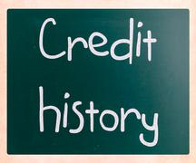 """Stock Photo of """"credit history"""" handwritten with white chalk on a blackboard"""