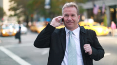 Caucasian middle aged businessman talking on cellphone - stock footage