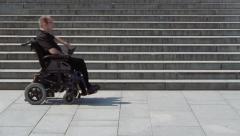 Wheelchair looking for a way up Stock Footage