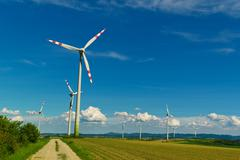 Wind turbine of a wind power plant for electricity Stock Photos