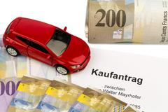 purchase contract for new car - stock photo