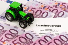 lease agreement for new tractor - stock photo