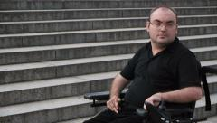 facing obstacles paralyzed man portrait - stock footage
