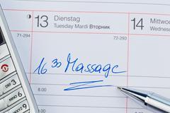 Entry in the calendar: massage Stock Photos