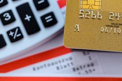 Credit card, bank statement and calculator Stock Photos