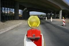 Road signs in a highway on reconstruction and under the bridge. Stock Photos