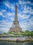 Eiffel tower against a scenic cloudy sky, paris, france Stock Photos