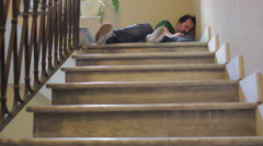 Man unconscious after falling downstairs - stock footage