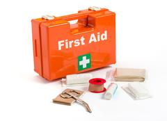 First aid kit with dressing material Stock Photos