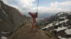 Touristic gondola pass over cliff mountains, up view Stock Footage