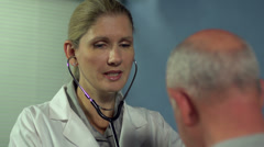 Female doctor checking patient - dolly shot 2 - stock footage