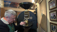 Stock Video Footage of Old man roasting coffee beans, commercial drum type coffee roaster