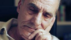 pensive and sad old man looking at the camera - depressed - stock footage