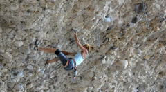 Female Rock Climber on Steep Conglomerate 10.2 Stock Footage