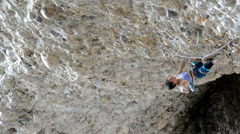 Female Rock Climber on Steep Conglomerate 8.2 Stock Footage