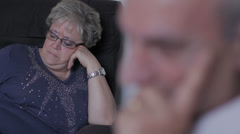 Mature sad woman and man in interior Stock Footage