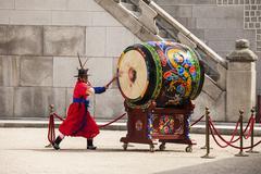 striking the ceremonial drum - stock photo