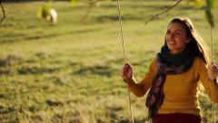Stock Video Footage of Beautiful Young Female Model Long Hair Fun Swing Smile Nature