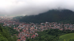 Panoramic view, white clouds passing over medieval town Stock Footage