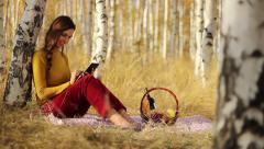 Stock Video Footage of Woman Using Tablet Nature Picnic Basket Technology Wireless