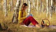 Stock Video Footage of Beautiful Young Female Student Reading Book in Nature Picnic