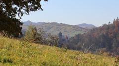 Dracula castle far away, autumn scenery - stock footage