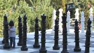 Stock Video Footage of Little cute baby step on big chessboard