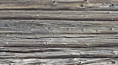 fragment of old gray log wall - stock photo