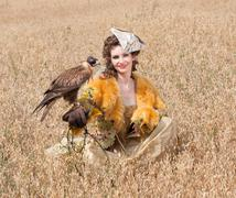 woman with hawk on hand - stock photo