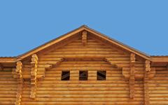 Pediment of new log cottage Stock Photos