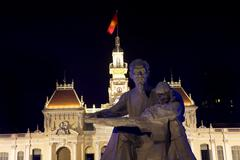 Statue of uncle ho chi minh front of people's committee building saigon vietn Stock Photos