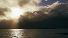 Stock Video Footage of Luminous Clouds and God Rays over Chilkat Inlet Mountains