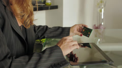 businesswoman with laptop and credit card - stock footage