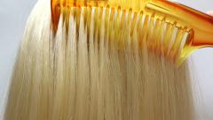 Brushing highlight blond hair texture background Stock Footage