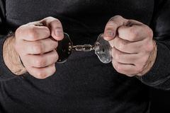 handcuffed - stock photo