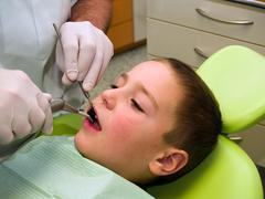 In dental surgery Stock Photos