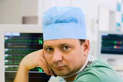 Male doctor with ecg monitor Stock Photos