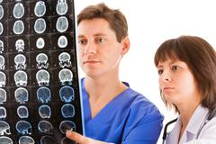 two doctors looking at tomogram - stock photo