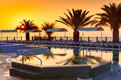 Beach hotel resort with pool at dawn Stock Photos