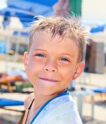 Smiley seven years old boy on the beach Stock Photos